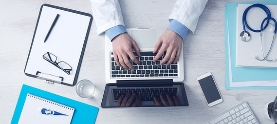 doctor using a computer at a desk