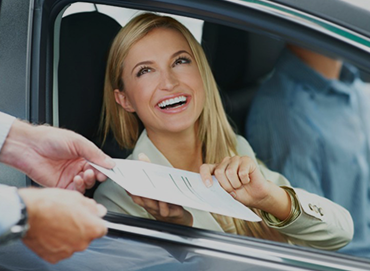 woman accepting documents through a car window