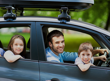 family in a car travelling