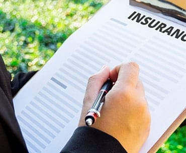 person looking through an insurance checklist